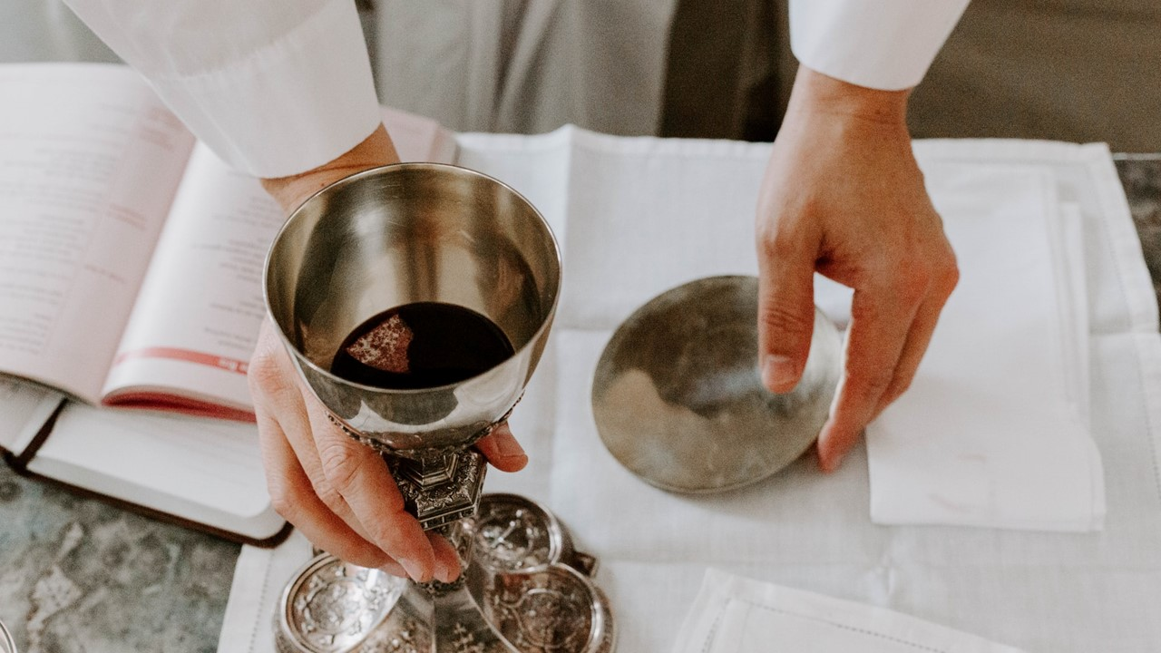 Chalice and bread on the table
